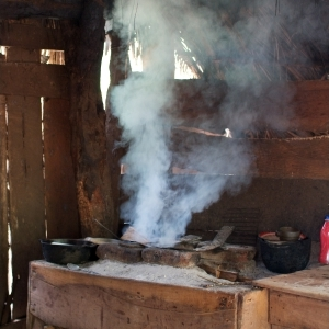 Smoke from a stove filling a wooden shack