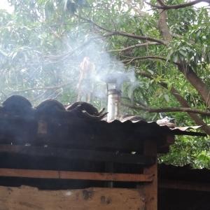 Smoke exiting a house through a chimney
