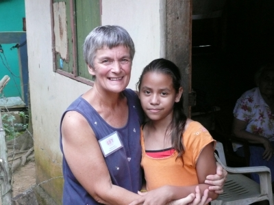 Margaret Storey with a sponsored child