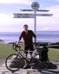Cyclist at John O'Groats