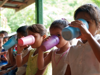 Children enjoying their high-vitamin milk