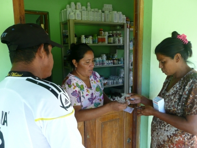 A nurse dispensing medicines to a patient