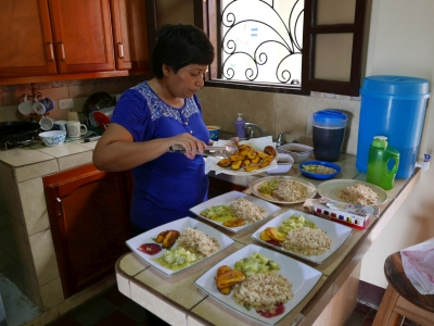 A member of staff preparing lunch for the girls