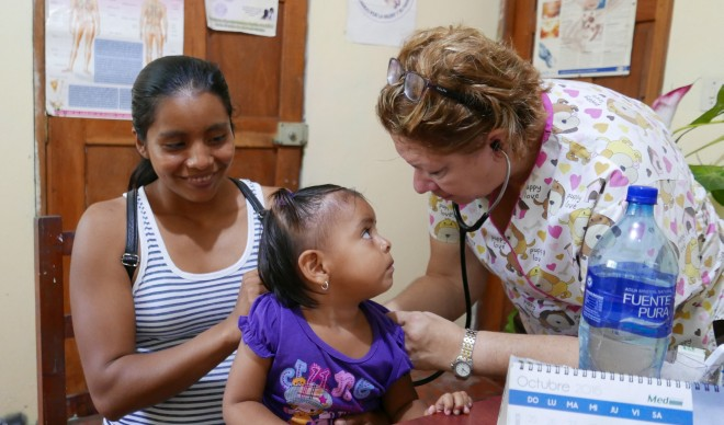 Doctor Sandra treating a young patient