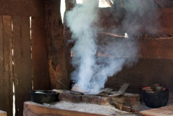 Traditional wood stove with lots of smoke