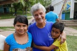 Margaret Storey with two sponsored children