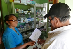 Nurse Candida dispensing medicines to a patient