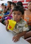 A boy drinking a glass of high-vitamin milk